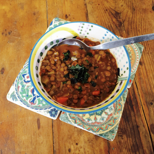 Lentil Soup topped with Crispy Kale